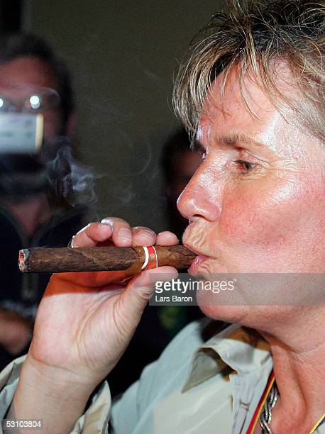 Tina Theune Meyer smokes a cigar during the champions party of the German National Team at the UEFA Women's Euro 2005 on June 19 2005 at the Marriott...