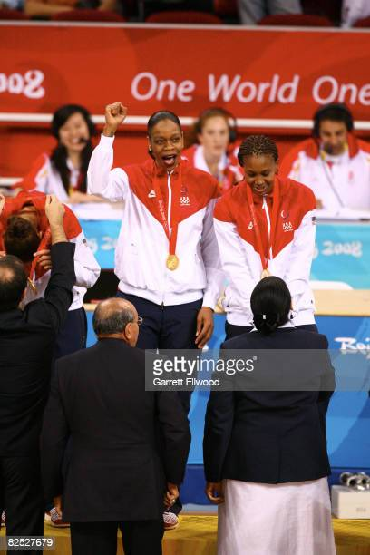 Tina Thompson and Tamika Catchings of the U.S. Women's Senior National Team celebrate after winning the gold medal against Australia at the Beijing...