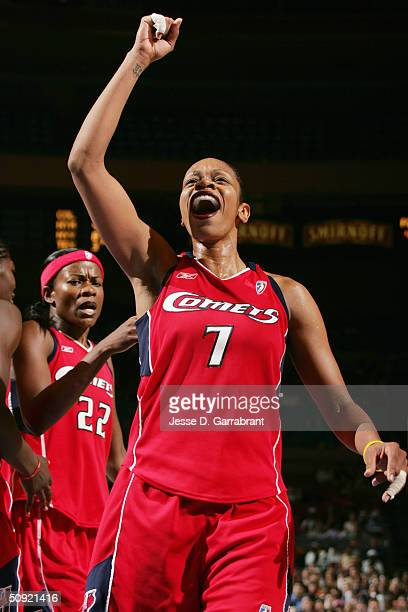 Tina Thompson of the Houston Comets celebrates during the game against the New York Liberty at Madison Square Garden on May 23 2004 in New York New...