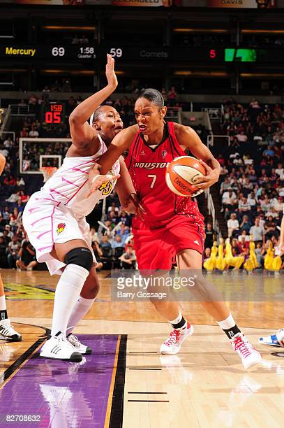 Tina Thompson of the Houston Comets drives against Le'coe Willingham of the Phoenix Mercury on September 7 at US Airways Center in Phoenix Arizona...