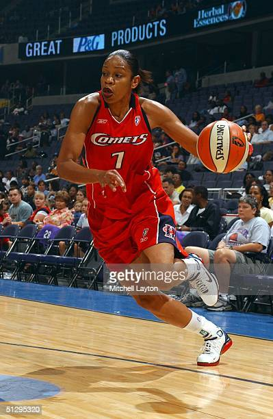 Tina Thompson of the Houston Comets drives to basket in a game against the Washington Mystics on September 12 2004 at the MCI Center in Washington DC...