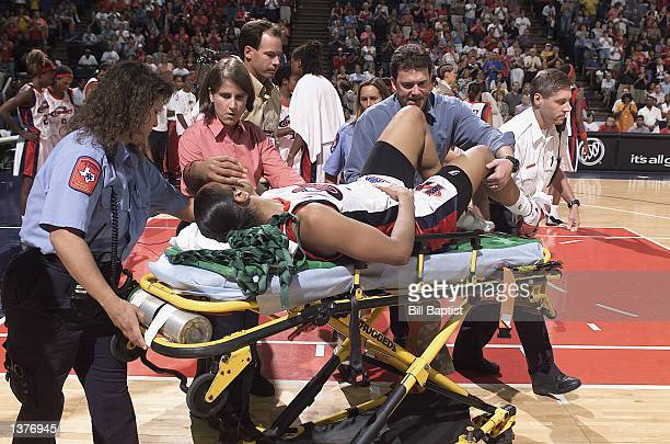 Tina Thompson of the Houston Comets is carried off the court on a stretcher during the game against the Cleveland Rockers on August 6 2002 at Compaq...
