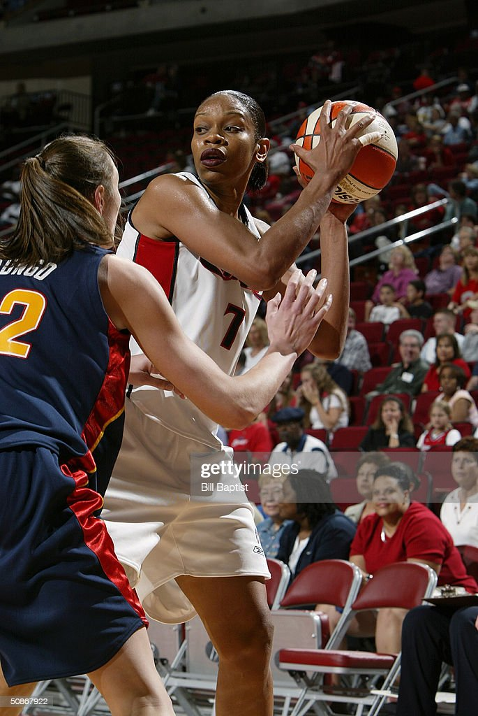Tina Thompson #7 of the Houston Comets looks to make a play against Jessica Brungo #22 of the Connecticut Sun during the preseason game at Toyota Center on May 11, 2004 in Houston, Texas. The Comets won 84-71.