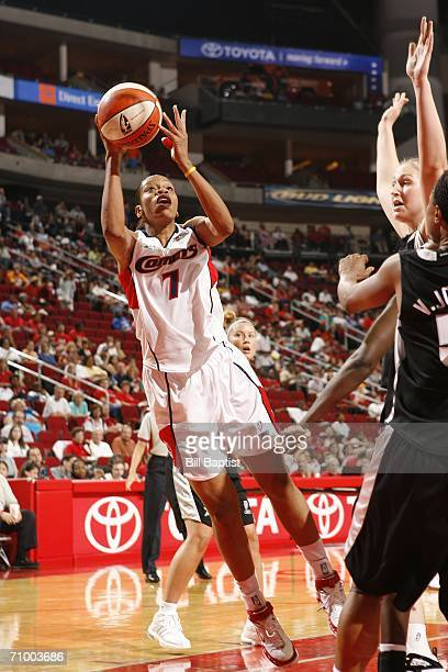 Tina Thompson of the Houston Comets shoots in front of Vickie Johnson of the San Antonio Silver Stars on May 21 2006 at the Toyota Center in Houston...