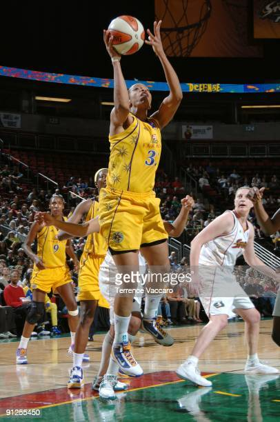 Tina Thompson of the Los Angeles Sparks goes up for a shot in Game Three of the Western Conference Semifinals against the Seattle Storm during the...