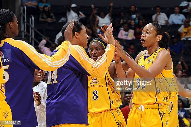 Tina Thompson of the Los Angeles Sparks is congratulated by teammates DeLisha MiltonJones Lindsay WisdomHylton and Noelle Quinn after surpassing Lisa...