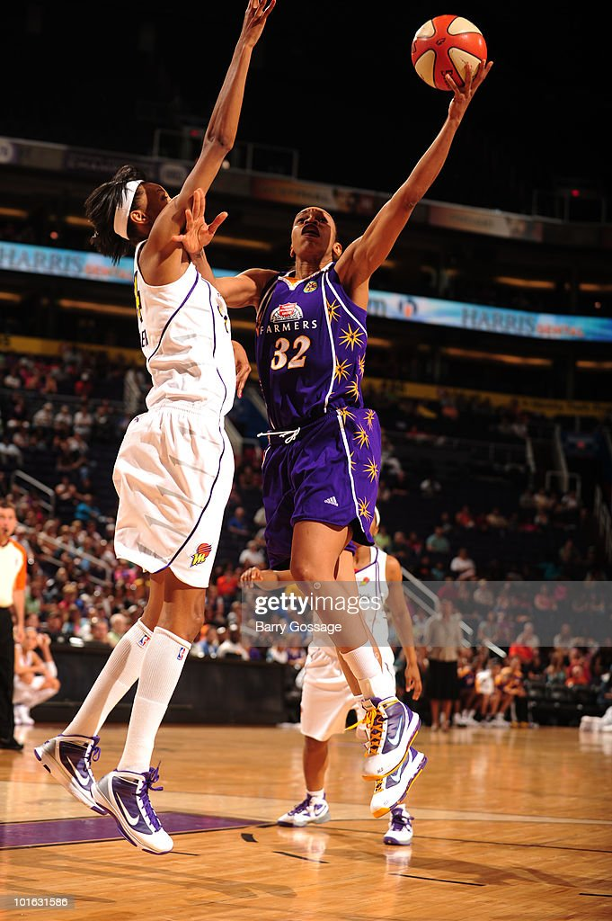 Tina Thompson #32 of the Los Angeles Sparks shoots against DeWanna Bonner #24 of the Phoenix Mercury in an WNBA game played on June 8, 2010 at U.S. Airways Center in Phoenix, Arizona.