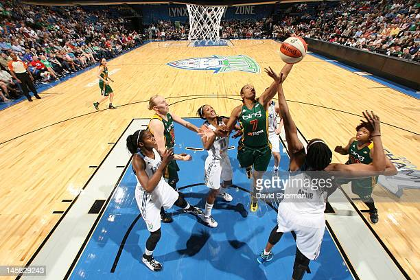 Tina Thompson of the Seattle Storm fights for the rebound against Jessica Adair and Candice Wiggins of the Minnesota Lynx in the game on June 6 2012...