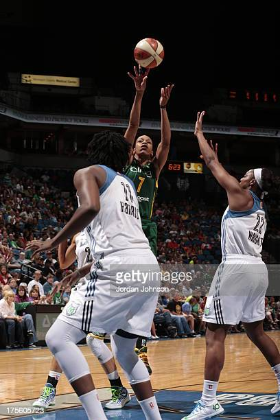 Tina Thompson of the Seattle Storm shoots over Monica Wright and Amber Harris of the Minnesota Lynx during the WNBA game on August 4 2013 at Target...