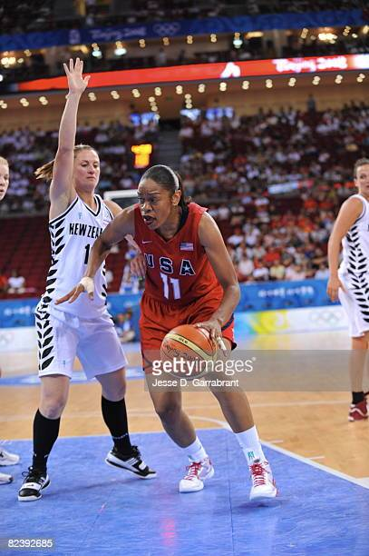 Tina Thompson of the U.S. Women's Senior National Team drives against New Zealand during the women's preliminary round group B basketball match at...