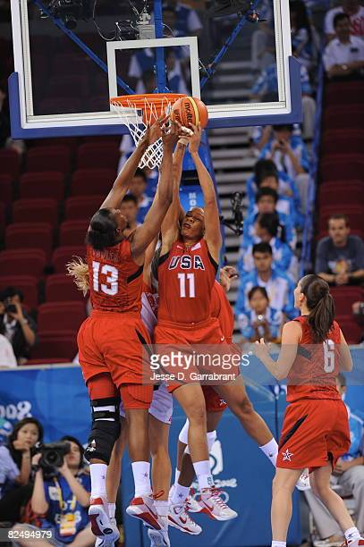 Tina Thompson of the U.S. Women's Senior National Team rebounds against Russia during the women's semifinals basketball game at the 2008 Beijing...