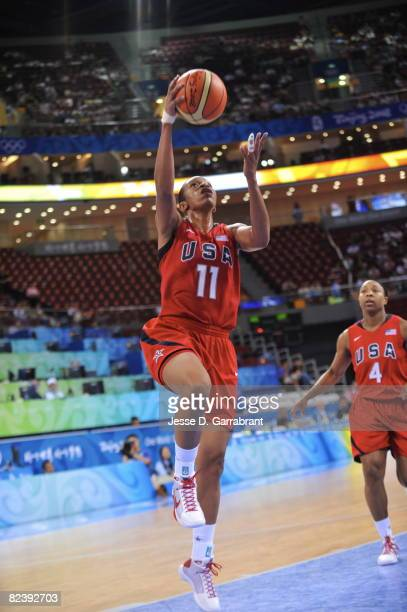 Tina Thompson of the U.S. Women's Senior National Team shoots against New Zealand during the women's preliminary round group B basketball match at...