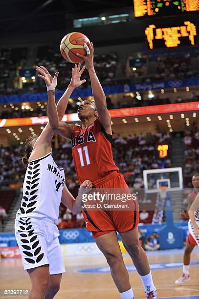 Tina Thompson of the U.S. Women's Senior National Team shoots against Jillian Harmon of New Zealand during the women's preliminary round group B...