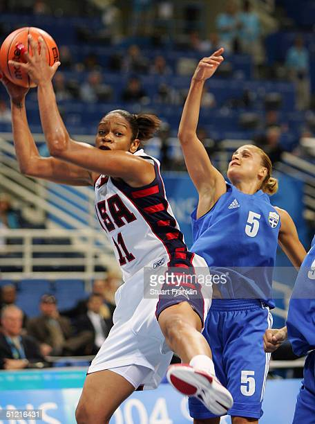 Tina Thompson of USA grabs a rebound in front of Anastasia Kostaki of Greece during the women's basketball quarterfinal game on August 25 2004 during...