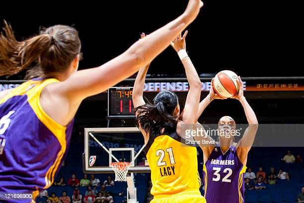 Tina Thompson tries to pass the ball to Jenna O'Hea of the Los Angeles Sparks past Jennifer Lacy of the Tulsa Shock during the WNBA game on August 21...