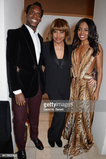 Tina Turner poses with cast members Kobna HoldbrookSmith and Adrienne Warren at the press night after party for 'Tina The Tina Turner Musical' at...