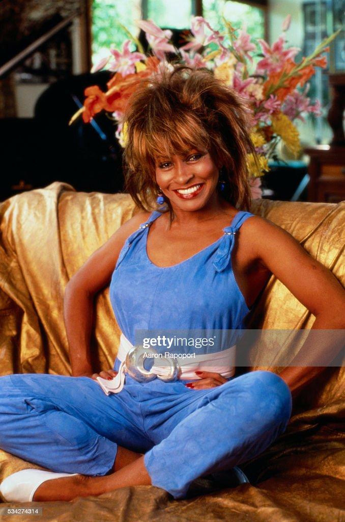 Tina Turner Seated on a Sofa