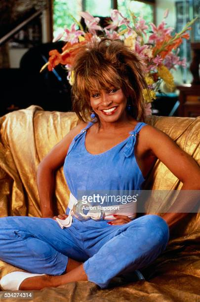 Tina Turner Seated on a Sofa