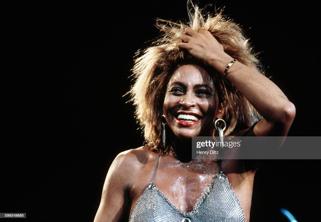 Tina Turner sings on stage in one of her tireless performances. Turner first came to prominence singing with her husband Ike Turner. After obscurity in the seventies she made a spectacular comeback in the eighties.