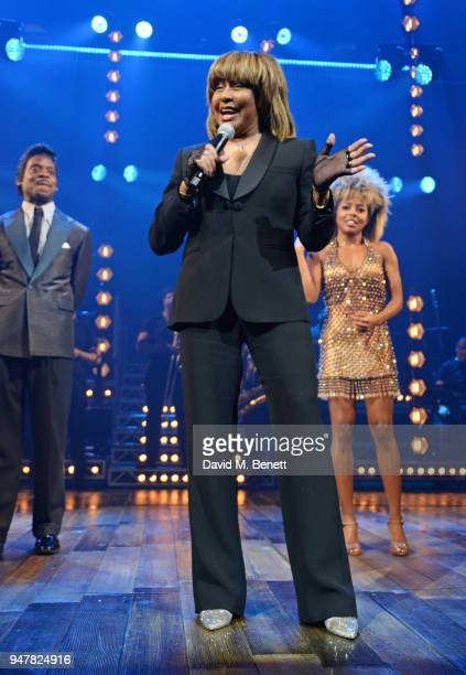 Tina Turner speaks as cast members Kobna HoldbrookSmith and Adrienne Warren look on at the curtain call during the press night performance of 'Tina...