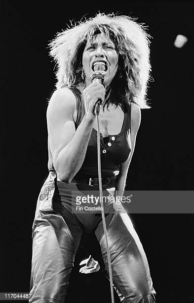 Tina Turner US singer singing into a microphone on stage during a live concert performance in Helsinki Finland circa 1985