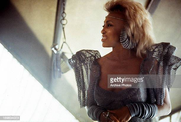 Tina Turner wearing silver attire in a scene from the film 'Mad Max Beyond Thunderdome', 1985.
