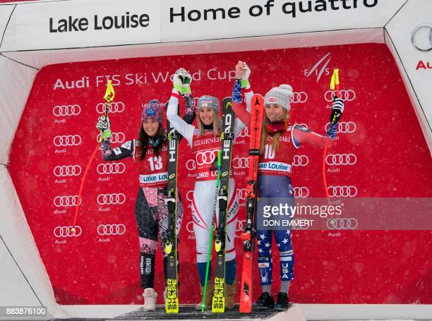 Tina Weirather of Liechtenstein second place Cornelia Huetter of Austria first place and Mikaela Shiffrin of the US third celebrate after the FIS Ski...