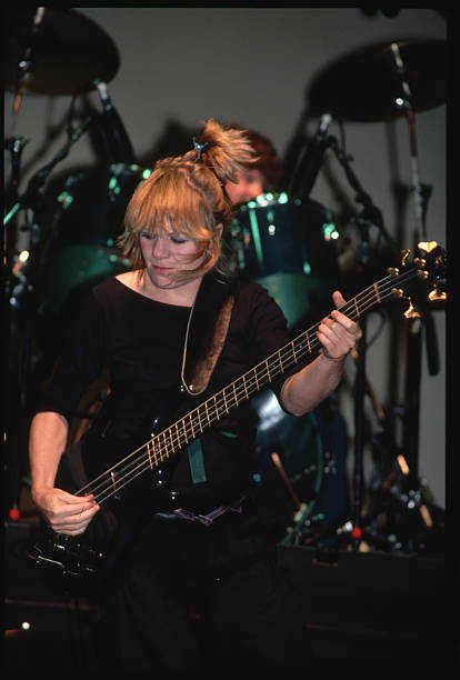 Tina Weymouth plays bass with Talking Heads in concert.
