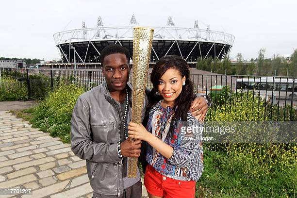 Tinchy Stryder and Dionne Bromfield pose with the official Olympic Relay Torch to announce they will be releasing the official Olympic torch relay...
