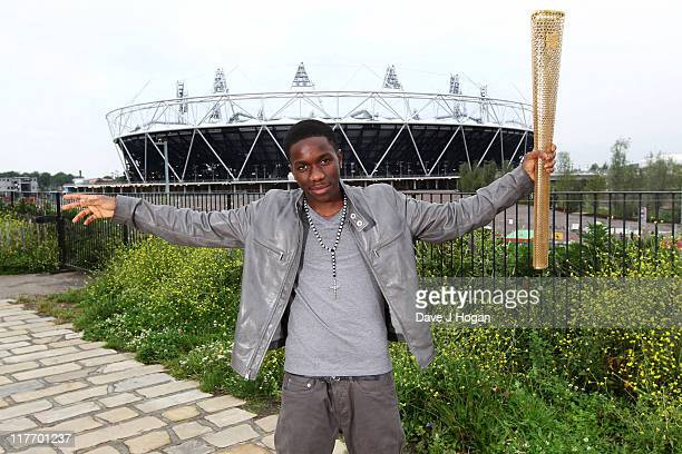 Tinchy Stryder poses with the official Olympic Relay Torch to announce he will be will be releasing the official Olympic torch relay song 'Spinning...