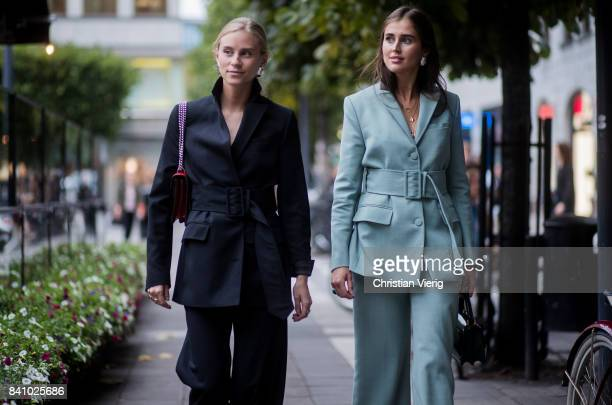 Tine Andrea and Darja Barannik wearing a pastel suit outside Rodebjer on August 30 2017 in Stockholm Sweden