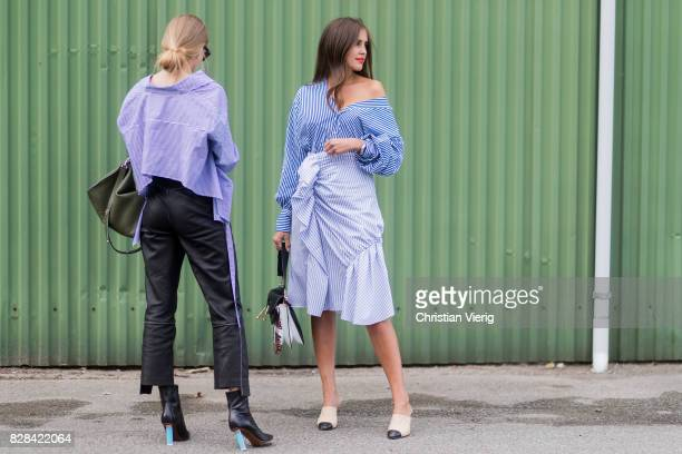 Tine Andrea and Darja Barannik wearing blue button shirts, leather pant, skirt outside By Malene Birger on August 09, 2017 in Copenhagen, Denmark.
