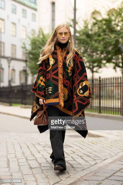 Tine Andrea is seen on the street during Fashion Week Stockholm SS19 wearing multi-color poncho on August 29, 2018 in Stockholm, Sweden.