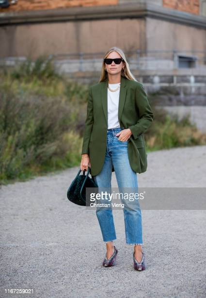 Tine Andrea is seen wearing denim jeans green blazer outside Samsøe Samsøe during Copenhagen Fashion Week Spring/Summer 2020 on August 07 2019 in...