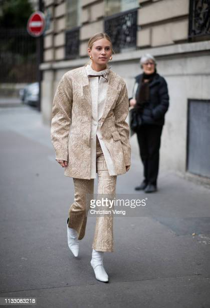 Tine Andrea is seen wearing jacket and flared pants during Paris Fashion Week Womenswear Fall/Winter 2019/2020 on March 01 2019 in Paris France