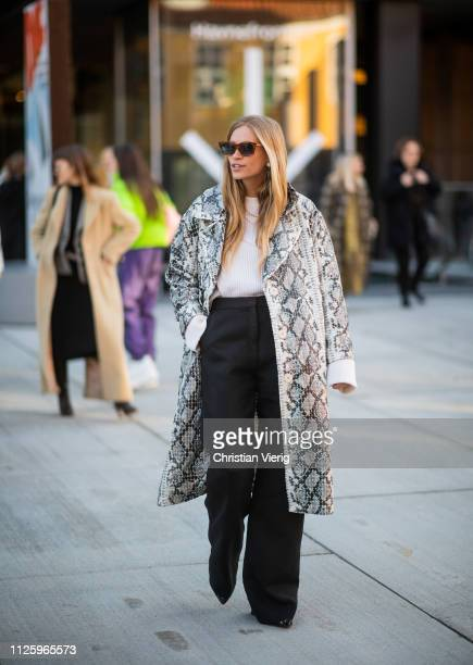 Tine Andrea Lauvli Storløs is seen wearing coat with snake print seen outside Resume during the Copenhagen Fashion Week Autumn/Winter 2019 Day 1 on...
