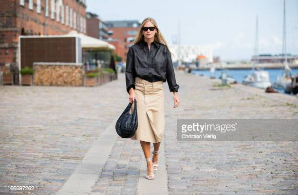 Tine Andrea seen wearing beige skirt, black button shirt outside Rodebjer during Copenhagen Fashion Week Spring/Summer 2020 on August 07, 2019 in...