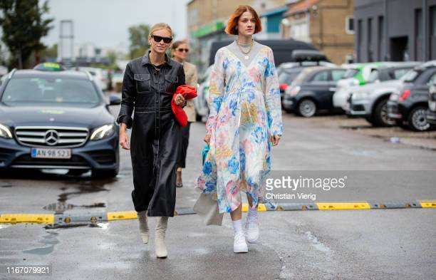 Tine Andrea seen wearing butto up leather dress and Marianne Theodorsen wearing dress with graphic print outside Baum und Pferdgarten during...