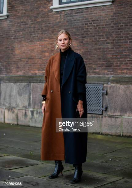 Tine Andrea seen wearing navy brown two tone coat outside Lovechild on Day 1 during Copenhagen Fashion Week Autumn/Winter 2020 on January 28, 2020 in...