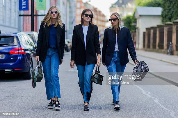 Tine Andrea weaing a green Fendi bag blazer and blue sweater Darja Barannik wearing a black blazer and denim jeans and Gucci loafers and Celine...
