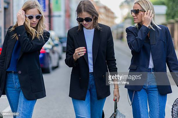 Tine Andrea weaing a green Fendi bag blazer and blue sweater Darja Barannik wearing a black blazer and denim jeans and Celine Aargaard wearing a...