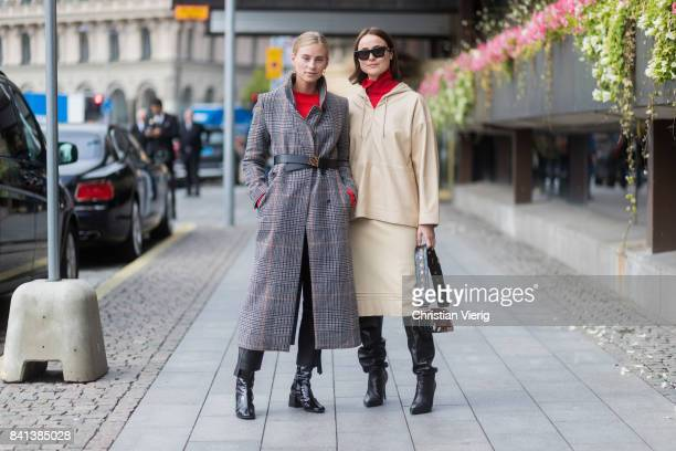 Tine Andrea wearing a checked grey coat with belt and Lena Lademann wearing beige hooded jacket and skirt black overknees outside Jennifer Bloom on...