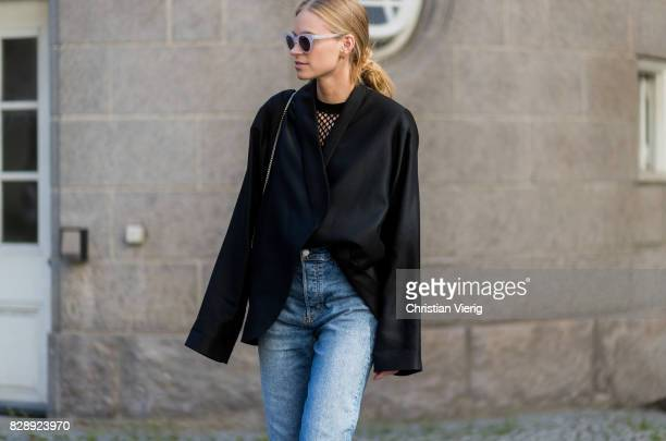 Tine Andrea wearing a net top black blouse with long sleeves denim jeans outside Holzweiler on August 09 2017 in Copenhagen Denmark