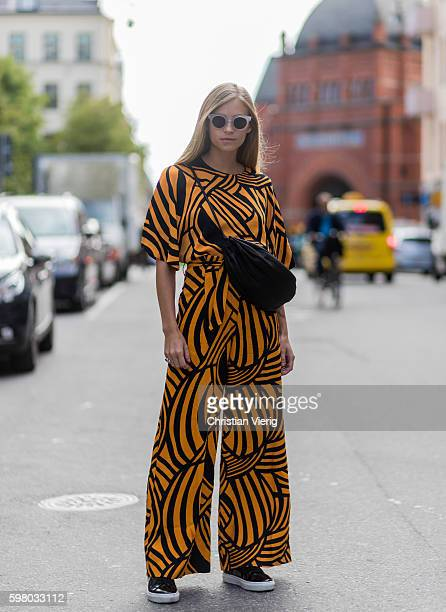 Tine Andrea wearing an orange overaller outside Greta Gram during the second day of the Stockholm Fashion Week Spring/Summer 2017 on August 30 2016...