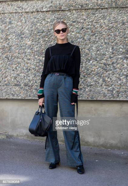 Tine Andrea wearing black Loewe bag outside IBEN on August 22, 2017 in Oslo, Norway.