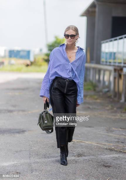 Tine Andrea wearing blue button shirt high waisted leather pants black boots Loewe bag outside By Malene Birger on August 09 2017 in Copenhagen...