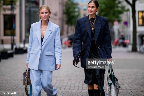 Tine Andrea wearing blue suit and Darja Barannik wearing oversized blazer jacket, boots, asymmetrical skirt seen outside FWSS during Oslo Runway SS19...