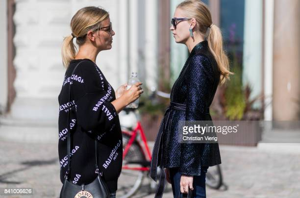 Tine Andrea wearing cropped denim jeans and Janka Polliani wearing a black Balenciaga sweater checked skirt outside Whyred on August 30 2017 in...
