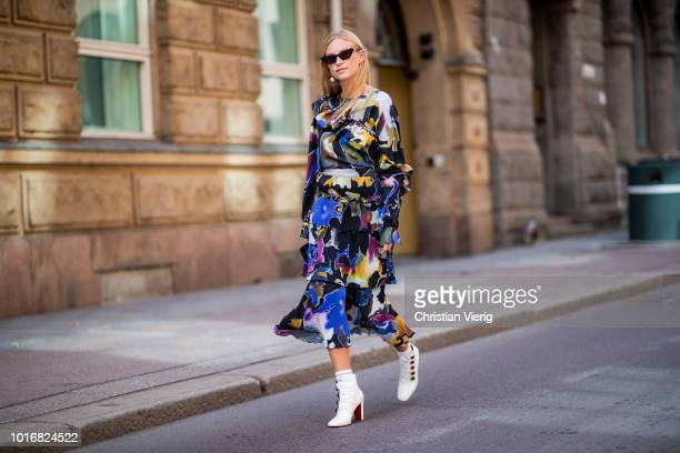 Tine Andrea wearing dress with floral print white ankle boots seen outside Epilogue during Oslo Runway SS19 on August 14 2018 in Oslo Norway
