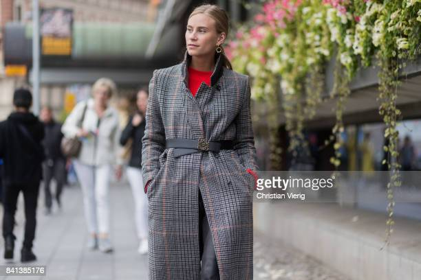 Tine Andrea wearing grey checked coat with belt outside Jennifer Bloom on August 31 2017 in Stockholm Sweden